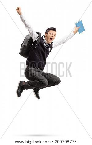 Overjoyed teenage student with a backpack and a book jumping isolated on white background