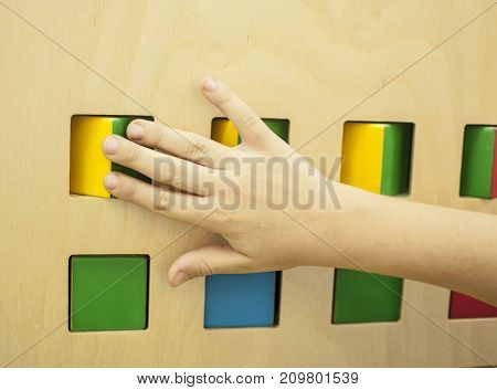 Kid hands playing of cubes