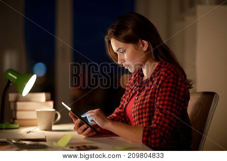education, technology, freelance, overwork and people concept - woman or student girl with tablet pc computer at night home
