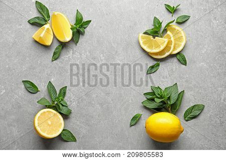 Composition with mint and lemon on grey background