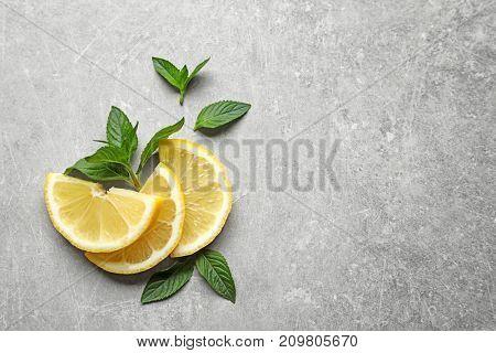 Mint and lemon on grey background