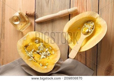 Cut spaghetti squash on wooden table