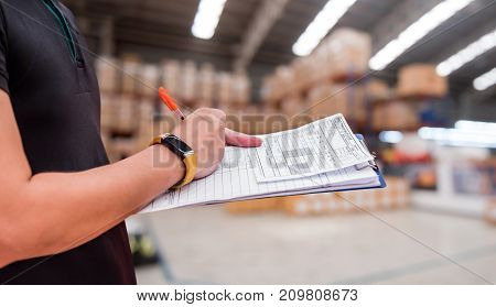 worker in factory checklist at the warehouse