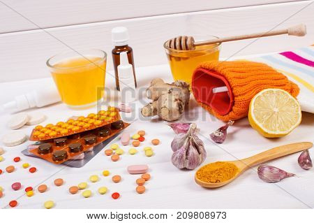 Medical Pills, Hot Water Bottle And Ingredients For Preparation Warming Beverage