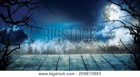 Spooky horror background with empty wooden planks, dark scary background. Celebration of halloween theme, copyspace for text. Ideal for product placement
