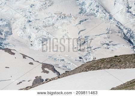 Two Hikers View Mount Rainier Glaciers