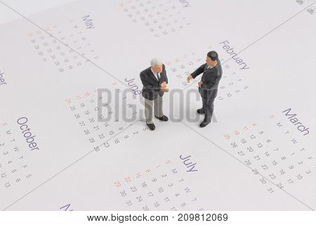 Business Figure Stand On The Claendar