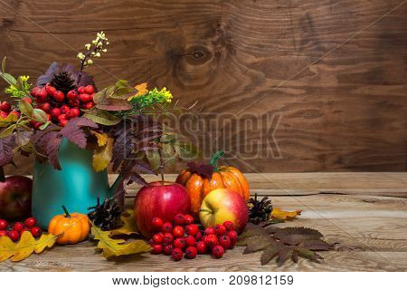 Fall Table Centerpiece With Rowan Berries, Leaves In Turquoise Vase, Copy Space