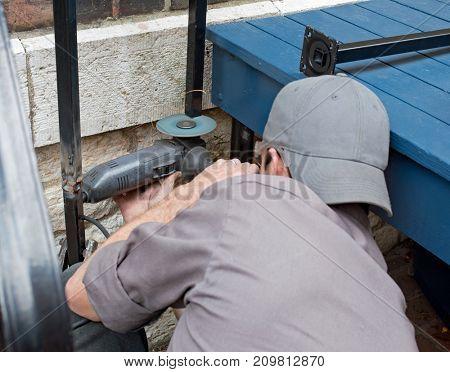 Worker Grinding Sharp Edges