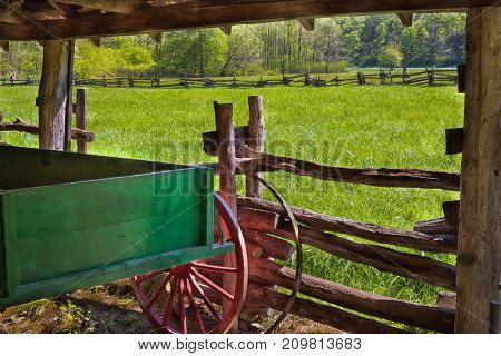 Old wooden wagon parked in the barn on the farm