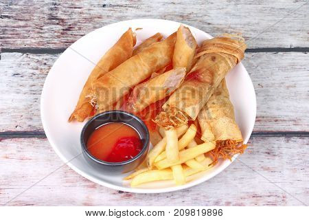 Deep Fried Spring Roll,and Frence Fries Sreved With Tomato Souce And Chili Sauce.