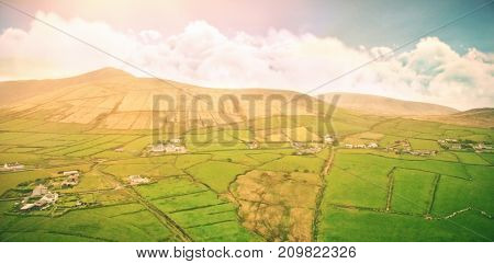 Idyllic view of landscape against cloudy sky during sunset