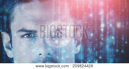 3D image of close up portrait of serious young man against digitally generated black and blue matrix
