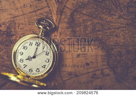 pocket watch or pendant watch on vintage map background (watch)