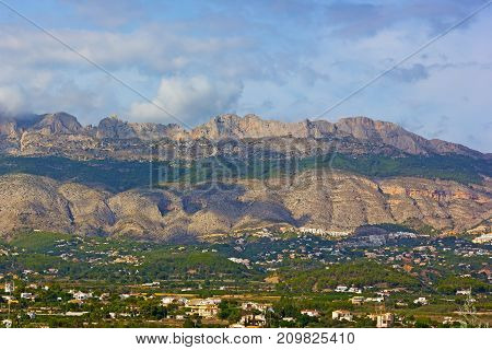 Alicante Mountains along a coastal line of Costa Blanca Spain. Scenic mountains ridge in Althea Spain.