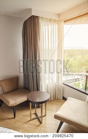Livingroom with sofas and a carpet near the window