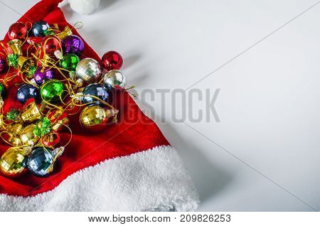 Beautiful Christmas Hat, Presents And Christmas Balls On A Red Cap.