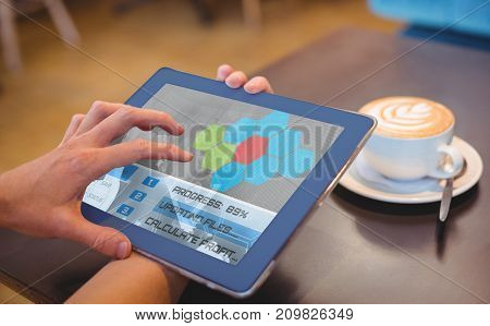 Application interface against  close-up of digital 3D tablet and coffee on table Close-up of digital tablet and coffee on table in the coffee shop