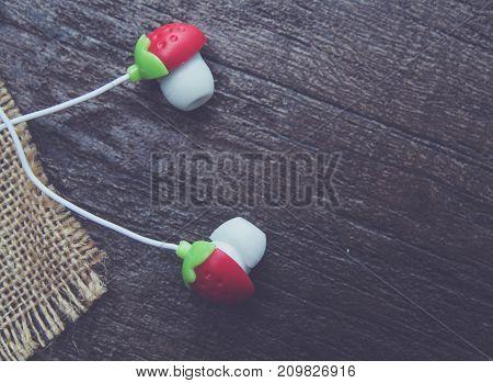 earphones buds macro closeup on table .