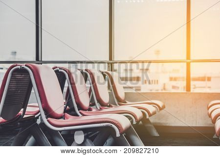 Bench in the terminal of airport. empty airport terminal waiting area with chairs