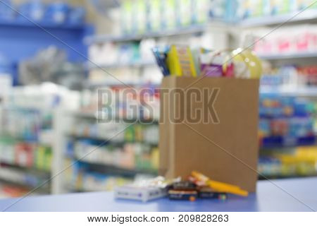Blurred image of shopping bag on the counter in the shop.