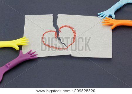 Replica of hand pulling paper with love symbol. Concept of divorcechild custodymatrinomial.