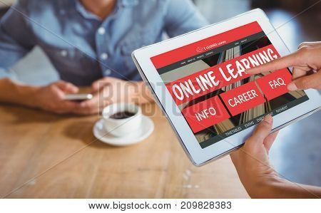 Computer generated 3D image of e-learning interface on screen against person using tablet computer in cafe