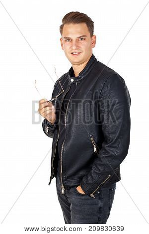Confident young man wearing black leather jacket on isolated background