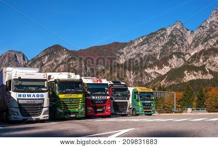 TYROL AUSTRIA - October 14 2017: Trucks parked in a parking lot in the Alps. Trucks for various purposes and duty.