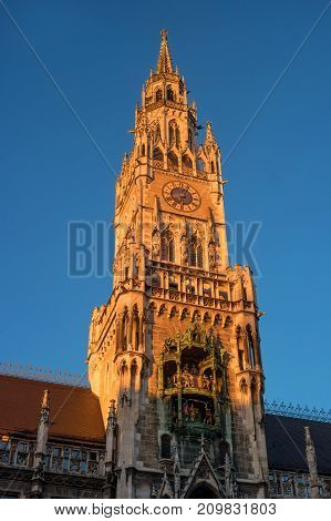 Tower of the city hall of Munich on Marienplatz in the rays of the evening sun. Munich. Germany.