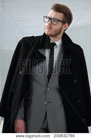 portrait of serious businessman in black coat