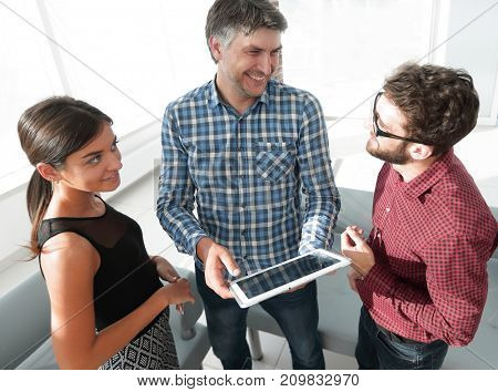 Business team in office working on tablet