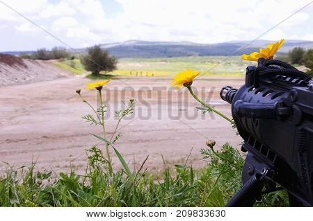 A rifle aimed on a group of potential targets, Middle East region outdoors, shooting range
