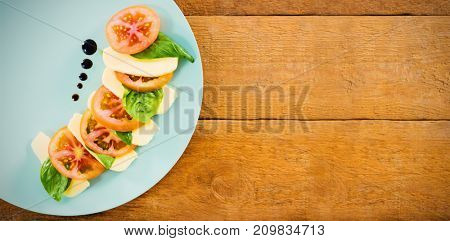 Overhead view shot fresh salad in plate on wooden table