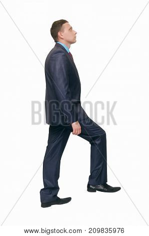 Man climbs the stairs isolated on white background. Career ladder.