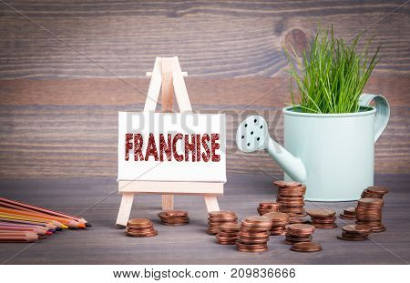 franchise,  business concept. miniature watering pot with fresh green spring grass and small change.