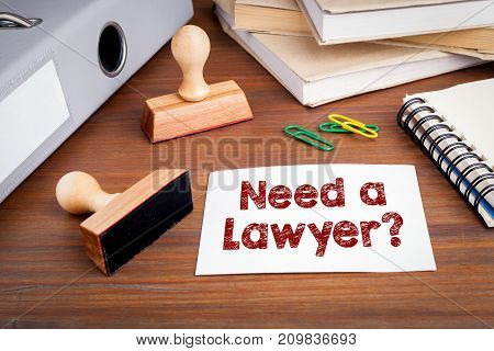 Need a Lawyer. Rubber Stamp on desk in the Office.