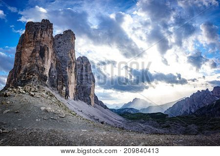 Dusk time at Tre Cime di Lavaredo rocks profile in Dolomites with cloudy sky, South Tyrol. Dolomite Alps, Italy