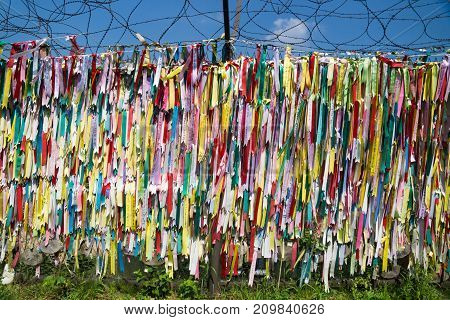 Dmz, Freedom Bridge, Republic Of Korea - September 8 2017: Colorful Peace Ribbons Tied At A Fence At