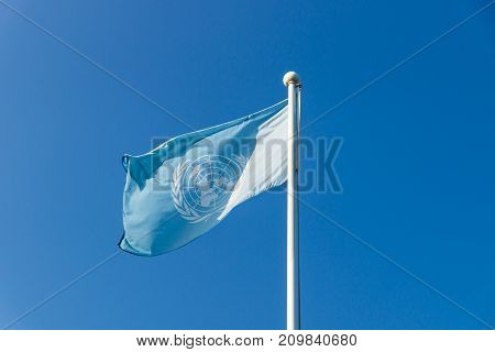 Busan, Republic Of Korea - September 12 2017: United Nations Un Flag With Sunslight On Cloudless Blu