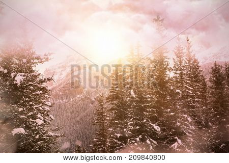 High angle view of cloudscape  against scenic view of snow covered mountains