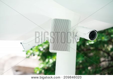 CCTV camera control system in the public space watching indoor or outdoor area with alarm speaker to warning people when unsecure situation happens