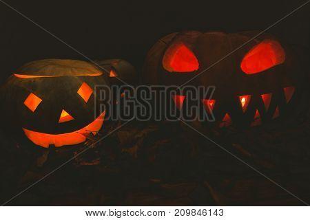 Jack o lantern glowing in darkroom during Halloween