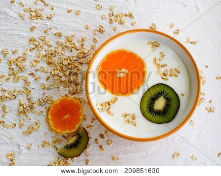 Oatmeal Porridge On Milk With Mandarin And Kiwi