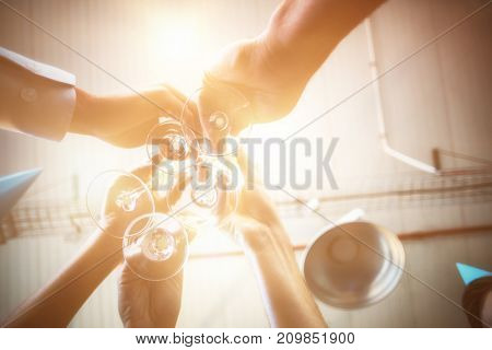 Businesspeople toasting a glasses of wine in office