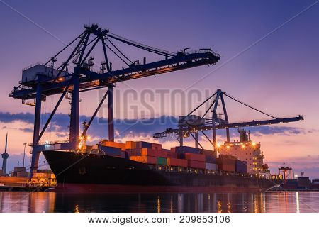 Terminal container loading at twilight. Cargo and shipping Logistics yard.