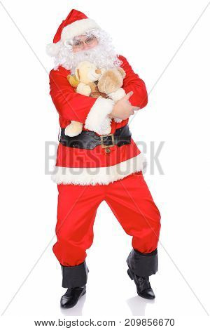 Santa Claus keeping teddy bear isolated on white background. Full length portrait.