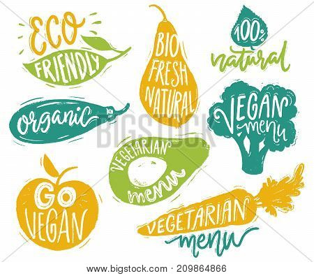 Vegetarian menu badges and stickers for cafe and restaurants. Vegan text on the vegetable lables for natural producs. Broccoli, avocado, carrot hand drawn silhouettes with lettering