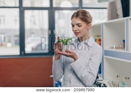 Biologist With Fern Plant