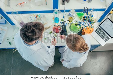 Biologists Working In Lab With Tubes